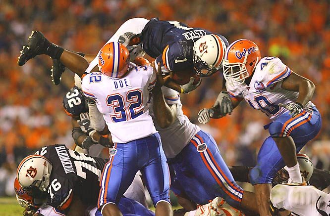 Auburn running back Brad Lester forced Florida's defense into some heavy lifting to make this tackle.