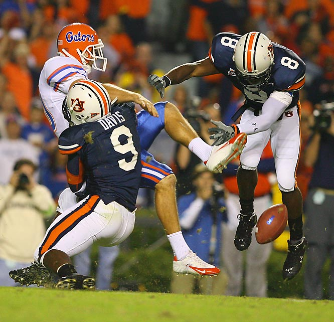 Defenders Jerraud Powers (8) and Tristan Davis (9) combined to block a punt by Eric Wilbur of Florida, which resulted in an Auburn touchdown.
