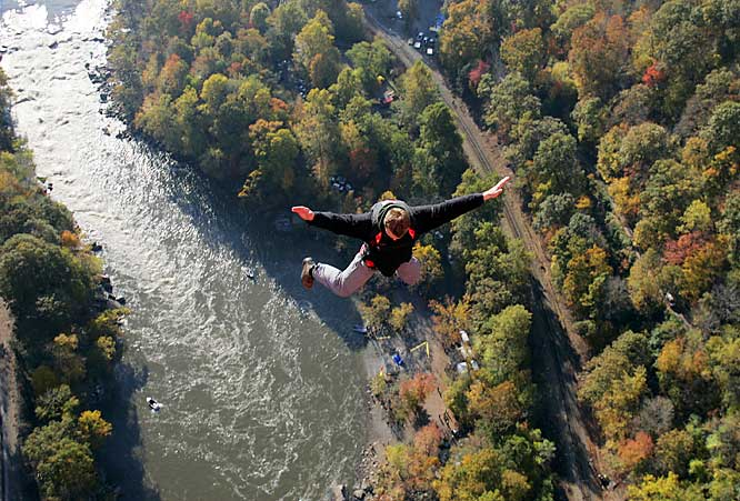 "The 26th annual ""Bridge Day,"" the largest BASE-jumping and extreme-sports event in the world, took place in Fayetteville, W.Va., on Oct. 21 and attracted 388 jumpers and 145,000 spectators this year. BASE is an acronym for the four categories of fixed objects from which one can jump -- Building, Antenna (tower), Span (bridge) and Earth (cliff). On Bridge Day, jumpers leapt from the 876-foot-high New River Gorge Bridge, the world's second-longest single-arch bridge, and fell for three to four seconds before deploying their parachutes and floating to a designated landing zone at the water's edge."
