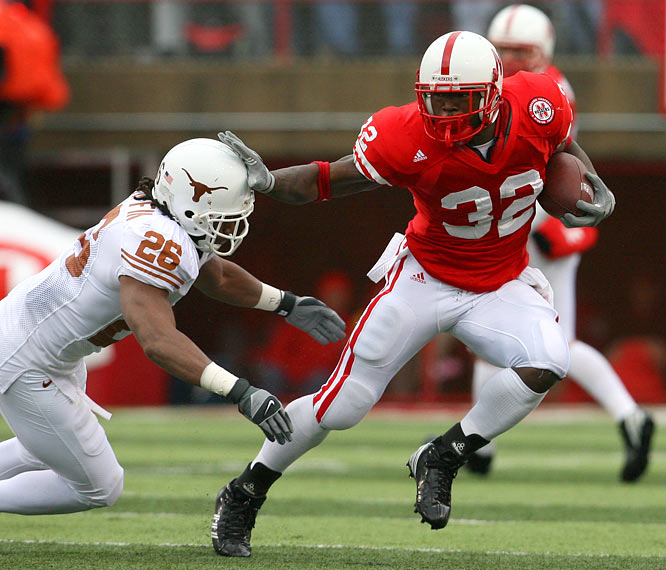 Running back Brandon Jackson of Nebraska fends off safety Marcus Griffin of Texas during a 22-20 loss.