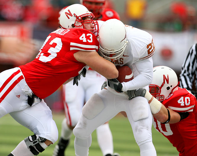 In a typically hard-hitting Big 12 game, Nebraska's defensive tackle Ty Steinkuhler (43) introduced himself to Texas running back Selvin Young.