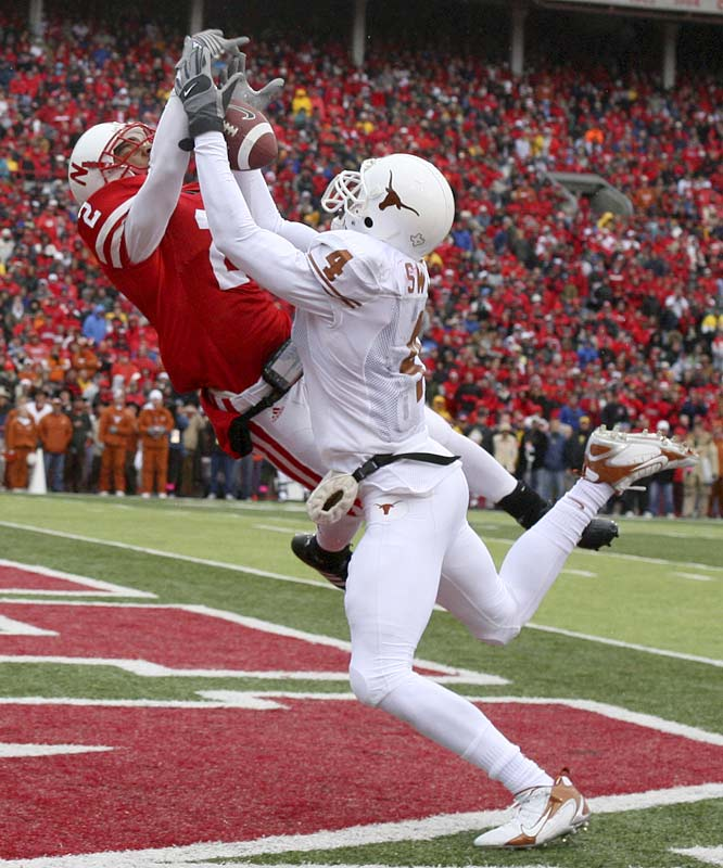 Wide receiver Limas Sweed (4) of Texas gets up close and personal with Nebraska cornerback Cortney Grixby as a pass from Colt McCoy fell incomplete in the end zone.
