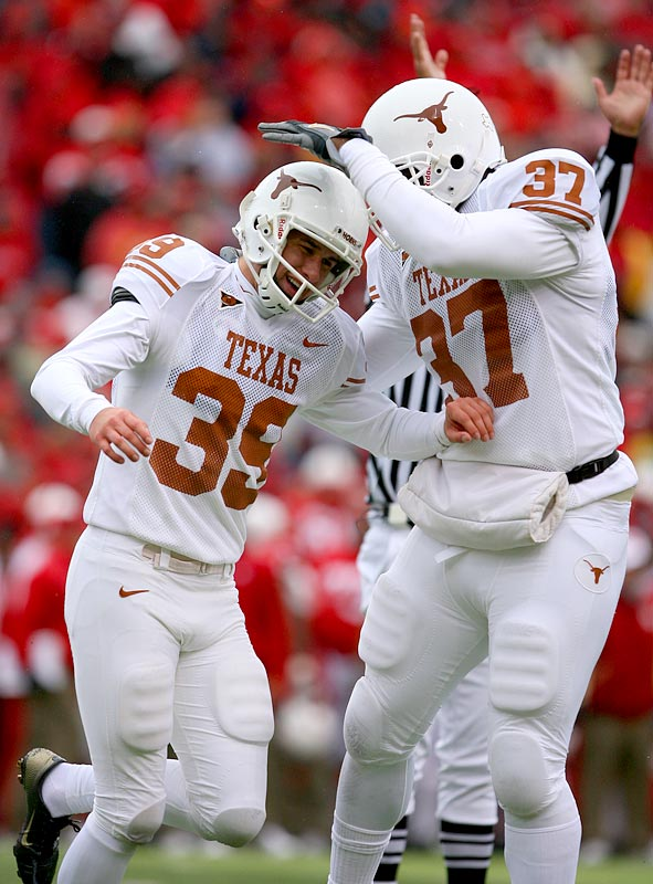 Kicker Ryan Bailey (39) being greeted by teammate Henry Melton after his game-winning field goal with 23 seconds left as Texas defeated Nebraska, 22-20.