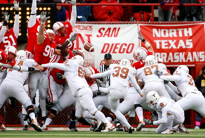 Nebraska's defense leaped high and wide to try to block Texas kicker Ryan Bailey's (39) field goal, which gave Texas a 22-20 victory over Nebraska in front of 85,187 fans at Lincoln.
