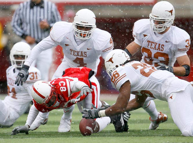 Free safety Marcus Griffin (26) of Texas beat wide receiver Terrence Nunn (83) to the ball after Nunn's fumble. The recovery led to  Ryan Bailey's game-winning field goal.