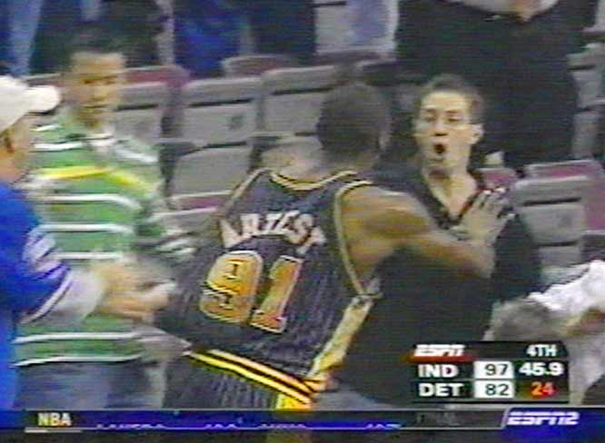 In a melee that quickly became known as the Malice at the Palace, Pistons center Ben Wallace shoved Pacers forward Ron Artest after being fouled hard by Artest with the game's outcome already decided. Players from both teams starting shoving each other, and before long Artest was charging into the stands after a fan threw a cup at him. Artest was suspended for the remainder of the season, the stiffest of the nine penalties issued by the NBA.
