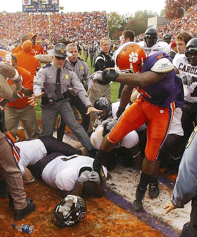 In a game played one day after the Malice at the Palace -- the worst brawl in NBA history -- Clemson and South Carolina players marred Lou Holtz's last game as a coach with a bench-clearing brawl in the fourth quarter. Both schools suspended players and agreed not to play in a bowl game that season.