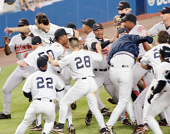 After giving up an eighth-inning, three-run home run to Bernie Williams, O's reliever Armando Benitez drilled Tino Martinez in the back with a pitch, setting off a 10-minute brawl that included a sucker punch of Benitez by the Yanks' Darryl Strawberry. ''It was the worst brawl I've seen in 25 years,'' George Steinbrenner said.
