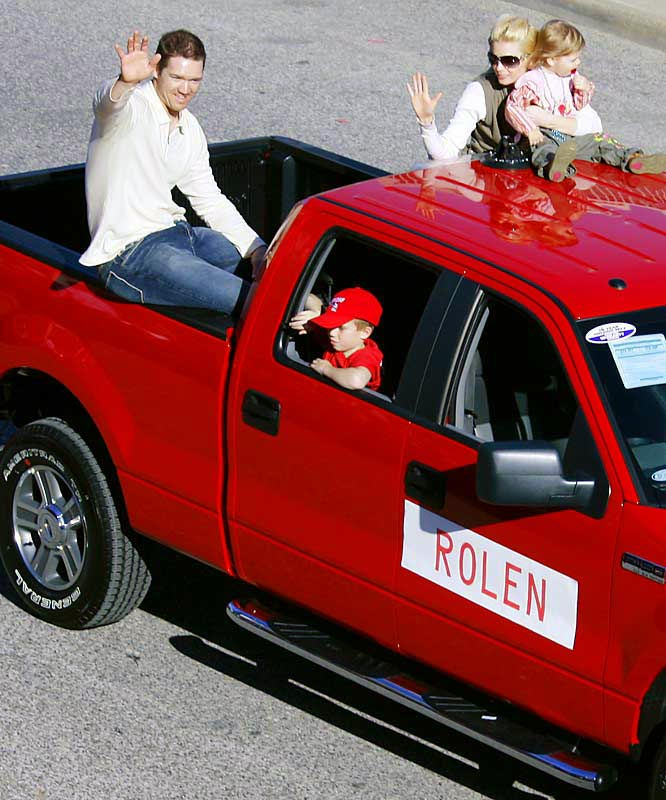 Scott Rolen waves to fans with his wife Niki and daughter Raine Tyler.