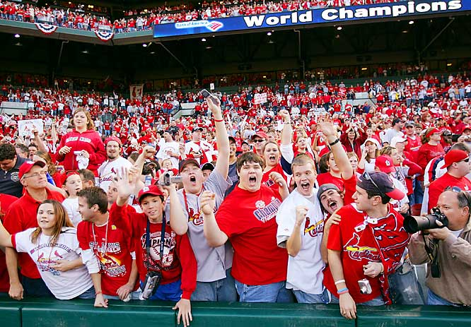 Fans cheer during a victory rally at Busch Stadium.