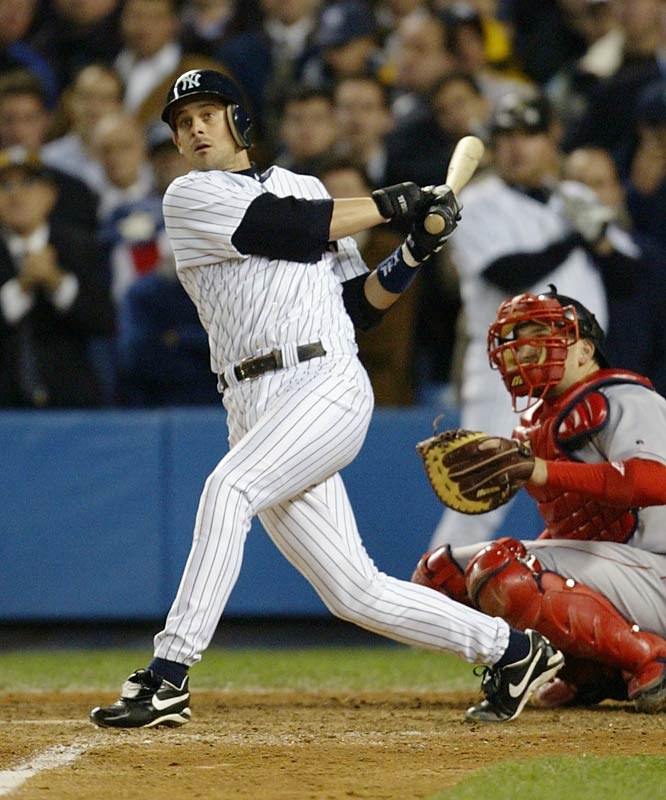 Aaron Boone set off bedlam in the Bronx with a leadoff homer in the 11th off Tim Wakefield to give New York a 6-5 victory and its 39th AL pennant.
