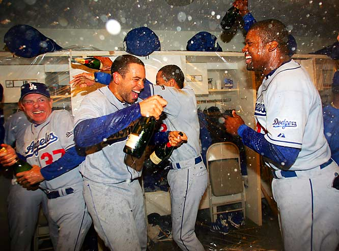 Dodgers rookie James Loney (second from left) celebrates with teammates in the locker room after clinching a playoff spot with a 4-2 win over the Giants on Saturday. Only two days earlier Loney had hit two home runs, including a grand slam, and had a total of nine RBIs in a 19-11 victory over the Rockies, tying the Dodgers' franchise record for most RBIs in a game, set by Gil Hodges for Brooklyn in 1950.