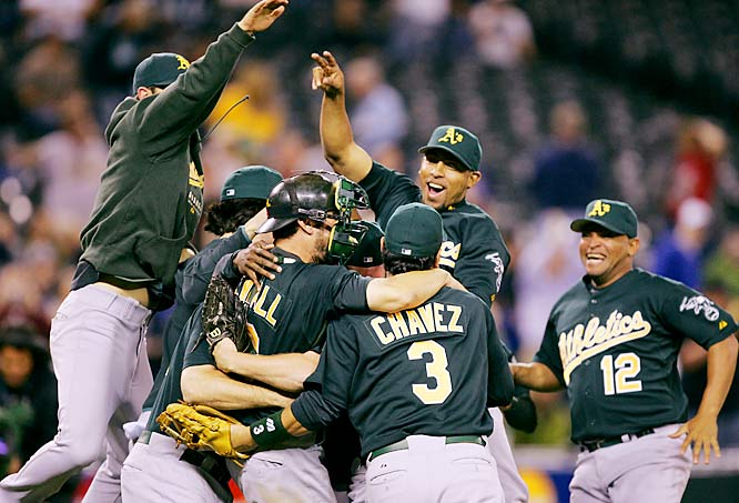 The Athletics celebrate after clinching the AL West title with a 12-3 win over the Mariners on Sept. 26. After a rough start, riddled with injuries, the A's went 70-40 in their final 110 games to take the division.