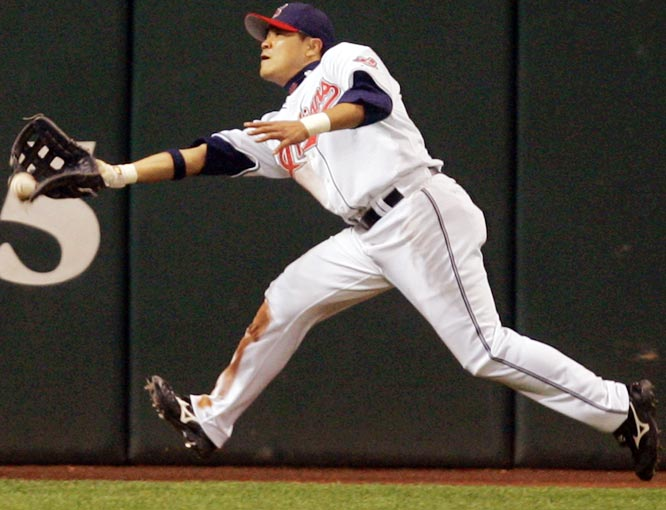 Indians left fielder Shin-Soo Choo mishandles a ball hit by the White Sox's Scott Podsednik, resulting in an error in the seventh inning of a rain-shortened 2-1 win for the White Sox on Sept. 27.