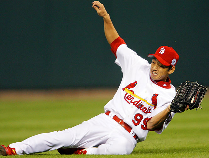 Right fielder So Taguchi makes a sliding catch on a fly ball by Magglio Ordoñez in the seventh.