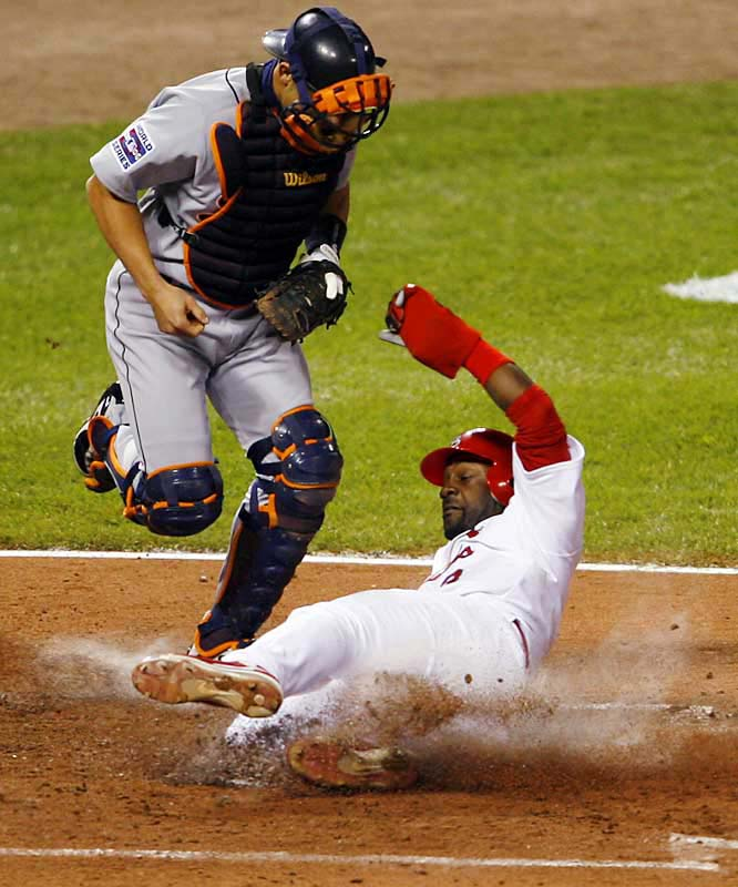 Preston Wilson slides home safely on a throwing error by reliever Joel Zumaya in the seventh.