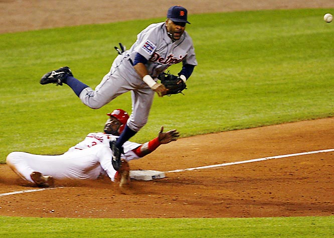 Third baseman Neifi Pérez turns a double play with a throw to first after forcing out Preston Wilson in the eighth.