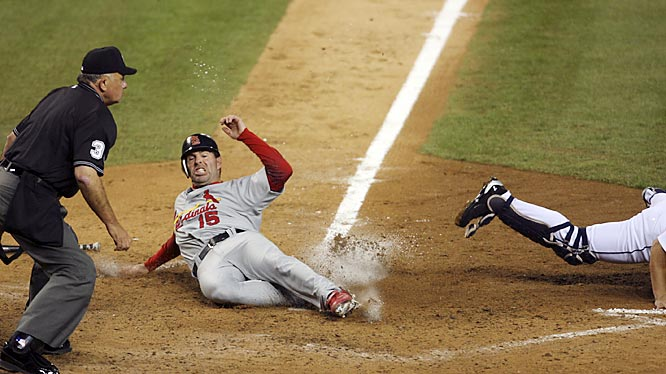 St. Louis' Jim Edmonds slides home safely on a throwing error by Detroit third baseman Brandon Inge to catcher Ivan Rodriguez in the sixth inning.