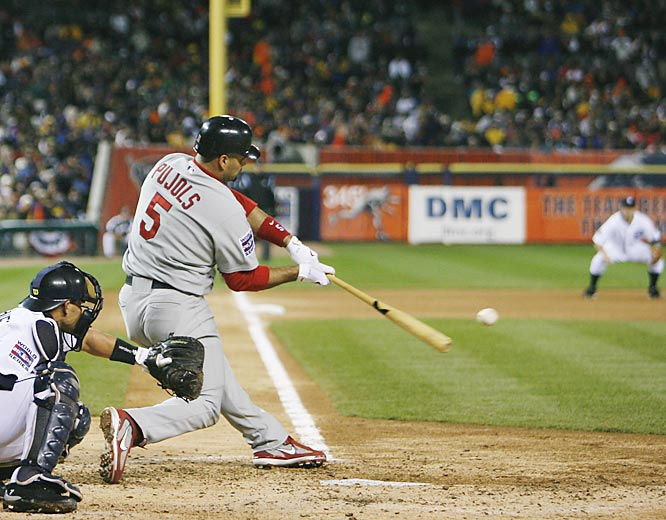St. Louis' Albert Pujols swings at a pitch to catcher Ivan Rodriguez.