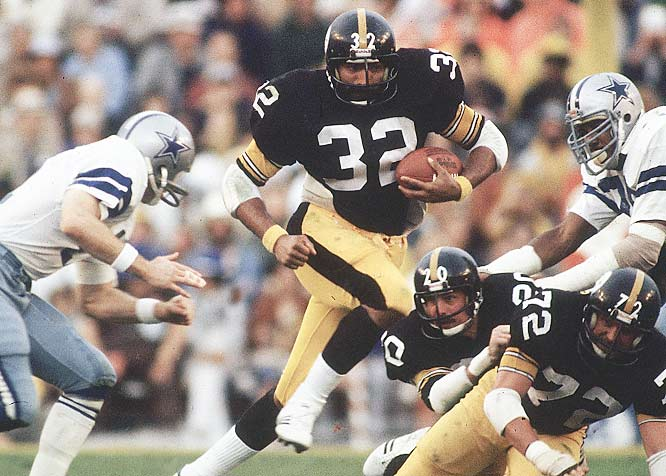 Franco Harris busts through the Cowboys line for a big gain. On the day, Harris finished with a Steelers-high 68 yards and a touchdown.