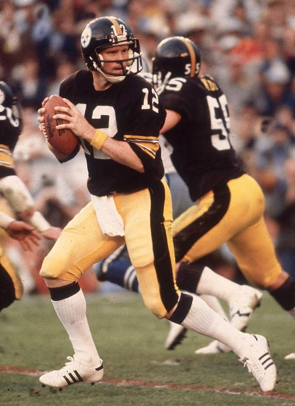 The 1978 Steelers capped off a 12-4 season with playoff victories against Miami (31-14) and Houston (27-13) before defeating the Rams, 31-9, in Superbowl XIV. The victory gave Pittsburgh their fourth Super Bowl of the `70s, proving that they were the team of the decade. Terry Bradshaw completed 17 of 30 passes for 318 yards and a record four touchdowns to lead the Steelers to victory.