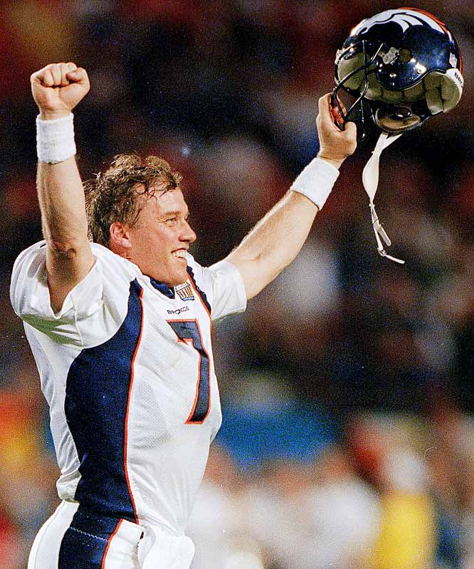 John Elway holds his hands up in celebration as he walks off the field during his final game in the NFL -- a 34-19 victory in Super Bowl XXXIII.