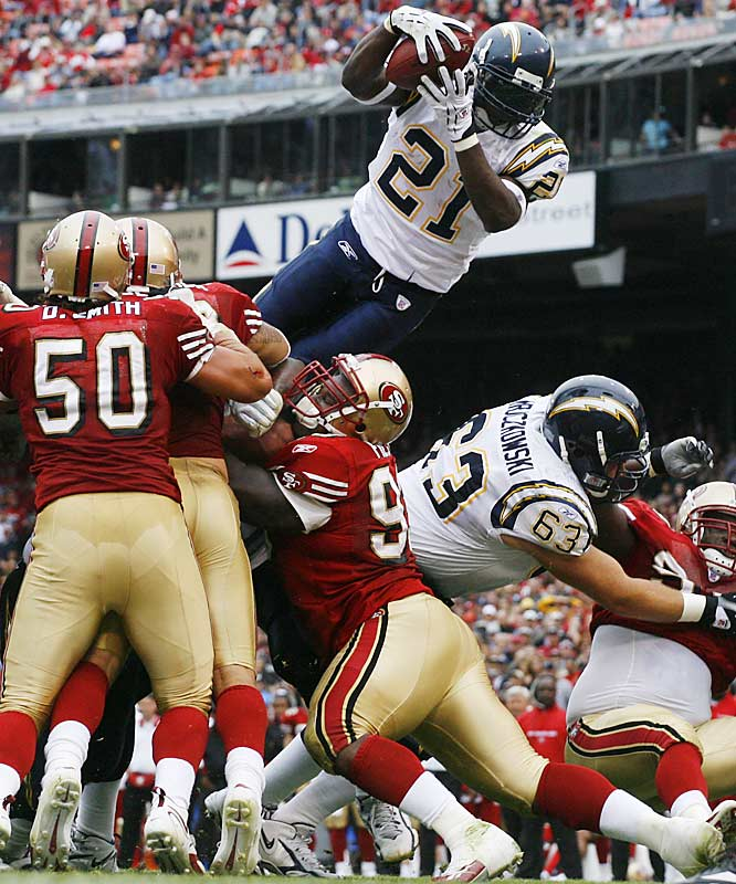 San Diego running back LaDainian Tomlinson scored four rushing touchdowns and had 135 total offensive yards in San Francisco.