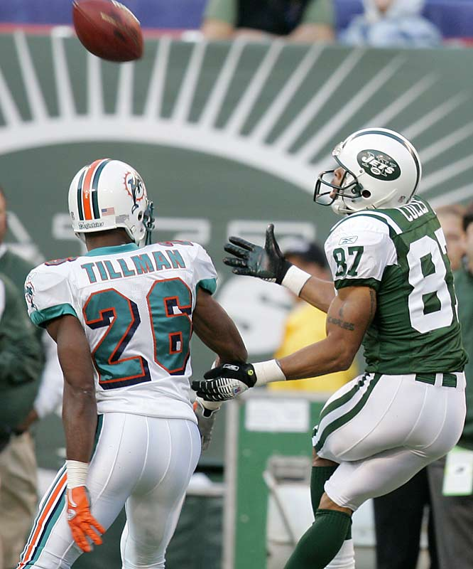 New York wideout Laveranues Coles caught two touchdowns passes and had 106 yards receiving against the Dolphins at Giants Stadium.
