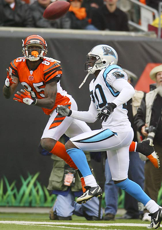 Cincinnati receiver Chad Johnson catches a pass against Carolina cornerback Chris Gamble in Cincinnati. Johnson turned a risky fourth-and-one call into a diving 32-yard catch in the fourth quarter, leading to a touchdown.