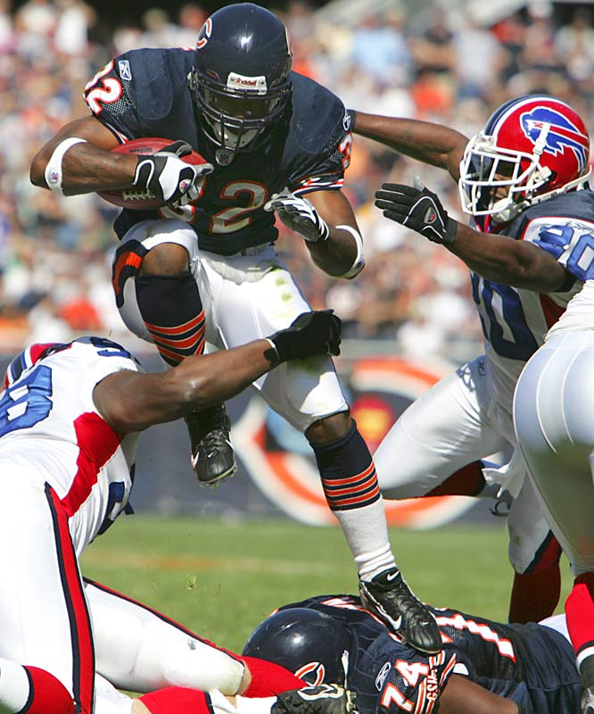 Chicago's Cedric Benson rushed for 48 yards and two touchdowns against Buffalo.