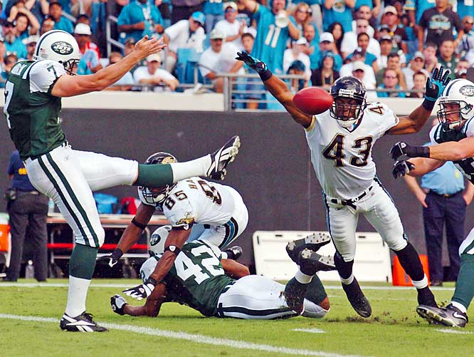 Jaguars safety Gerald Sensabaugh blocks a punt by the Jets' Ben Graham in the second quarter. The Jags forced five turnovers in their shutout victory over the Jets.