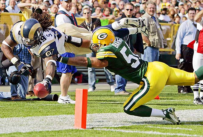 Packers linebacker Nick Barnett pushes Rams running back Steven Jackson out-of-bounds just short of the goal line in the fourth quarter. Jackson was held scoreless, despite his 118 total offensive yards.
