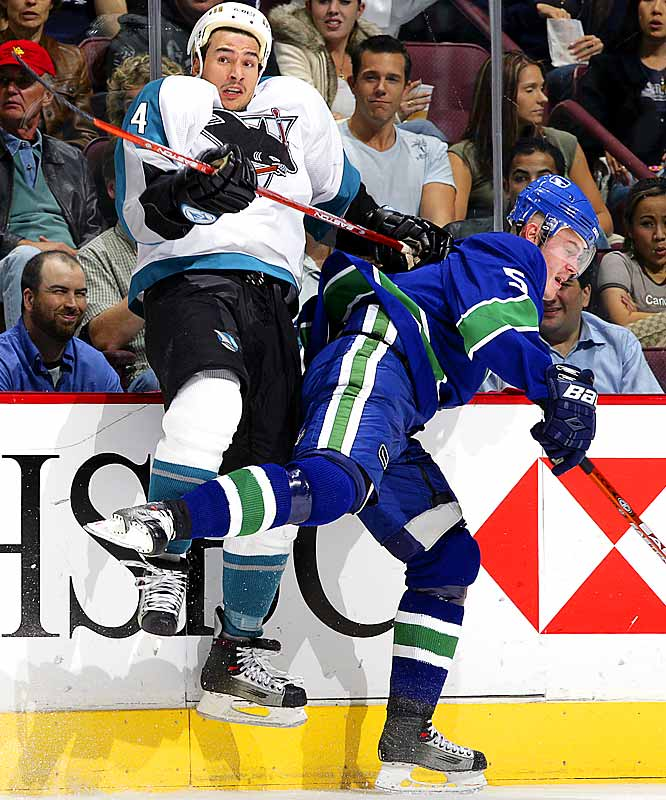 Shark hittin': Lukas Krajicek of the Canucks elevated the play of the Sharks' Jonathan Cheechoo during their collision at General Motors Place on Oct. 13.