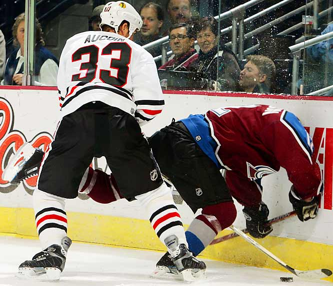 Chicago defenseman Adrian Aucoin appears to have taken Brad Richardson's head off while sending him into the boards as the Blackhawks battled the Avalanche on Oct. 16 in Colorado.