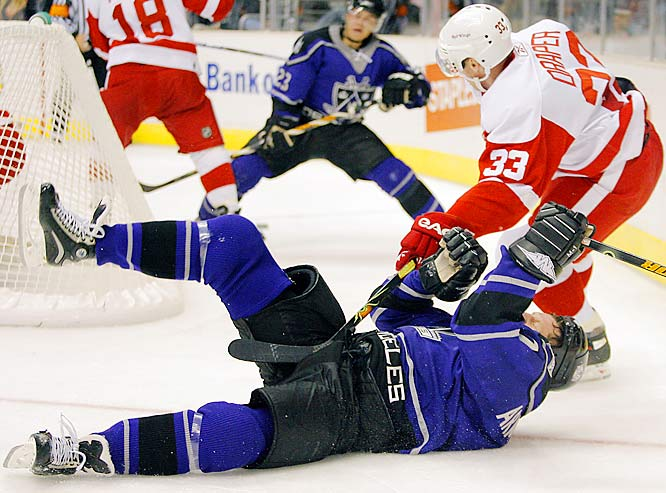 Kris Draper of the Red Wings crowned and downed the Kings' Derek Armstrong with a royal hit on Oct. 16 in Los Angeles.