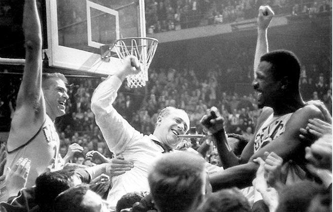 Happy fans celebrate with Tommy Heinshon, Auerbach and Bill Russell after Celtics won their sixth consecutive NBA title in 1964.