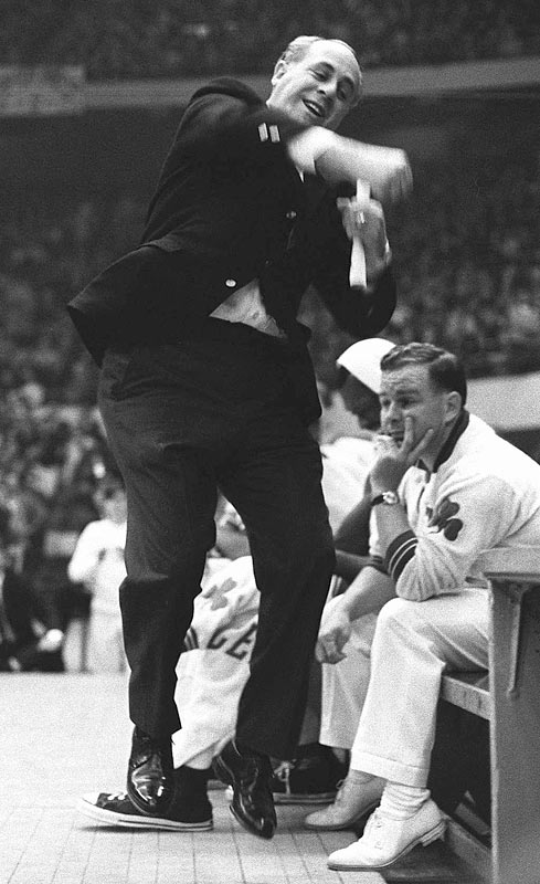 Auerbach celebrates Boston's victory over the Lakers for the Celtics' eighth straight championship, in 1966.