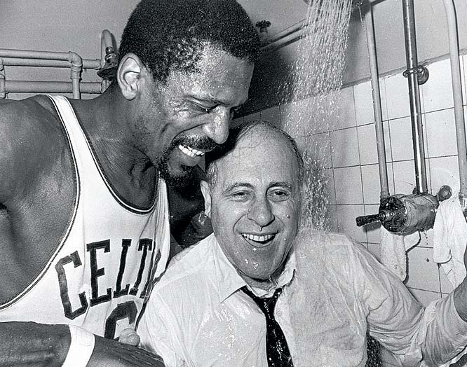 Bill Russell holds Auerbach under a shower after the Celtics beat the Lakers 95-93 for their eighth straight title.