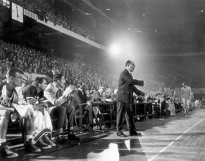 Red Auerbach coaching the Celtics during a game in January 1957.