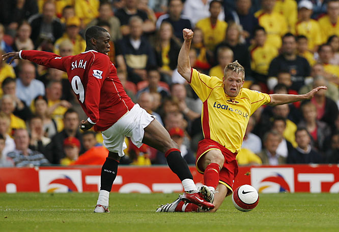 "In two years' time, DeMerit went from sharing a friend's attic bedroom and living off $70 a week to defending Manchester United players and meeting Watford's president, Elton John. ""It was kind of surreal,"" DeMerit says of meeting the pop icon. ""We talked about Brett Favre, of all things."""