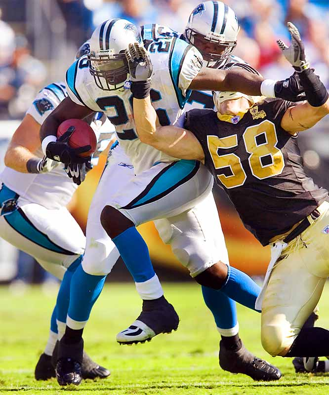 Panthers running back DeShaun Foster broke free from Saints linebacker Scott Shanle to score on a 43-yard run in the fourth quarter.