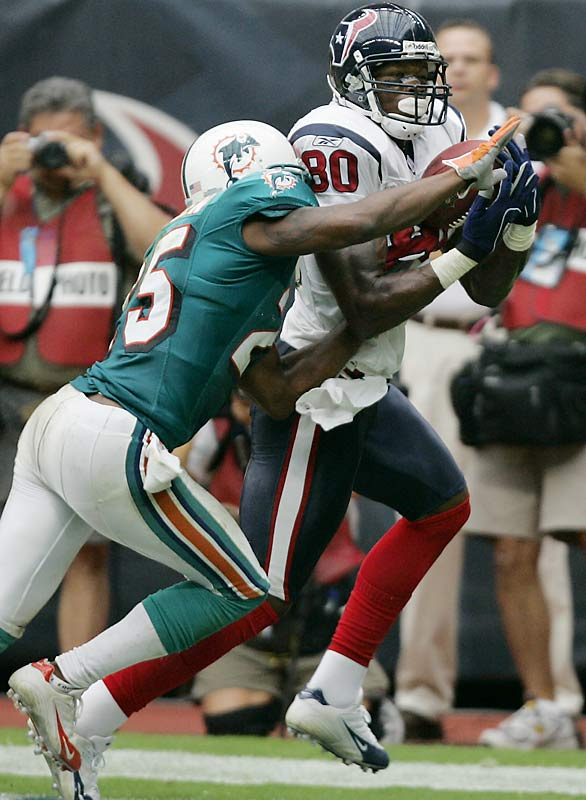 Houston's Andre Johnson makes a three-yard touchdown reception in the fourth quarter against Will Allen to help the Texans notch their first win of the season.