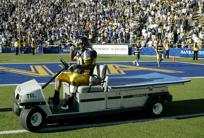 Cal running back Marshawn Lynch celebrates the Golden Bears overtime win against Washington by taking a spin around the field.