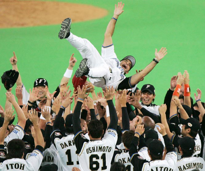 Manager Trey Hillman is tossed into the air by his Nippon Ham Fighters after defeating the Chunichi Dragons to win the Japan Series. Will the Cardinals do this to Tony La Russa if they close out the Tigers?