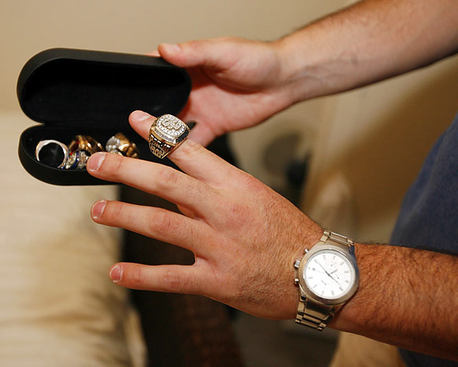 Booty shows off his Pacific-10 Conference championship ring which he won last year. He also has a couple national championship and state championship rings in his trophy case.