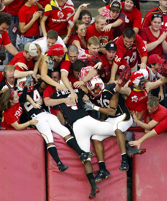 Maryland players dove into the crowd during Saturday's game against Miami in College Park, Md.