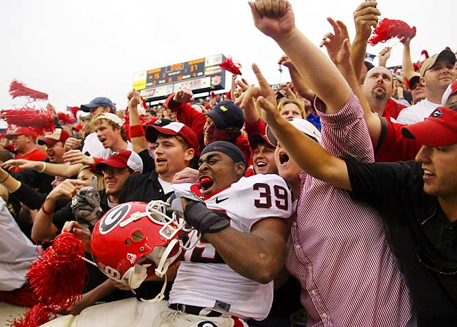 Junior tailback Jason Johnson celebrates with a pocket of Georgia fans after the Dawgs' victory at Auburn.