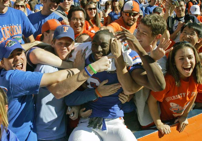 Florida's Jemalle Cornelius was mobbed by fans after Florida defeated Western Carolina 62-0 in Gainesville on Saturday.