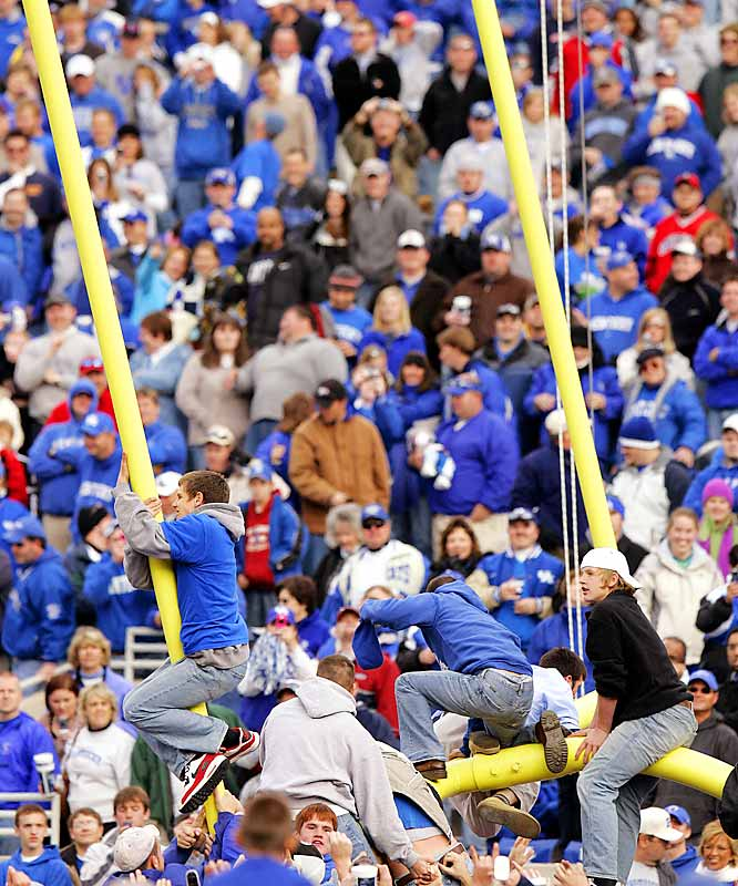 Kentucky fans tore down the goal post after Kentucky defeated Georgia 24-20 on Saturday at Commonwealth Stadium in Lexington.