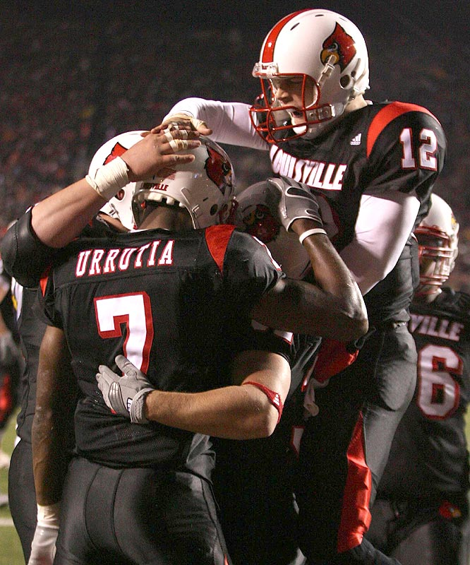 Brian Brohm (12) threw for 354 yards and a touchdown as the Cardinals beat West Virginia, ending the nation's second-longest winning streak.